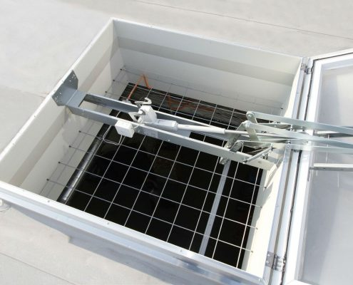 Smoke vent with safety grid